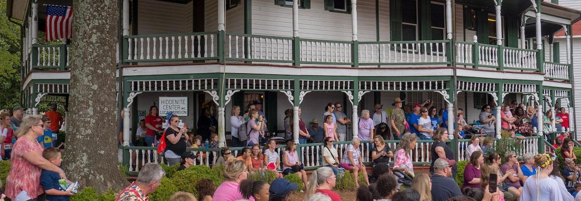 Crowd on Hiddenite Center porch during 2019 celebration